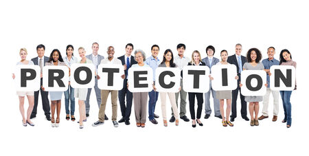 Multi-Ethnic Group Of Diverse People Holding Letters That Form Protection Stock Photo
