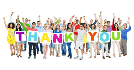 Multi-ethnic group of arms outstretched people holding cardboards forming thank you  photo