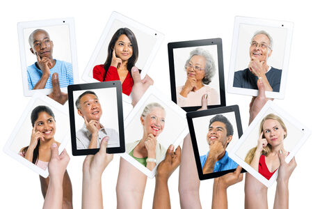 medium group of people: Variation of hands holding digital tablets with multi ethnic people thinking of inspiration