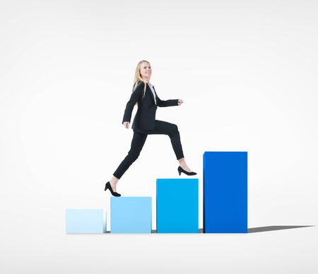 Business Woman Walking Toward Success on Bar Graph photo