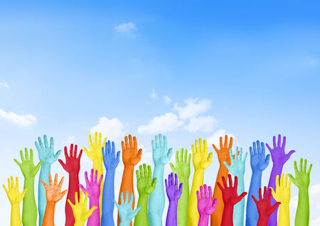 hands raised: Colorful Hands Raised With Blue Sky Stock Photo