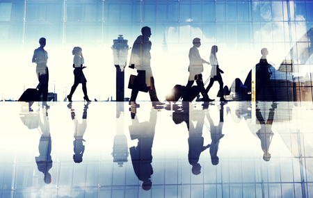 Group of Business Travellers Walking in the Airport  photo