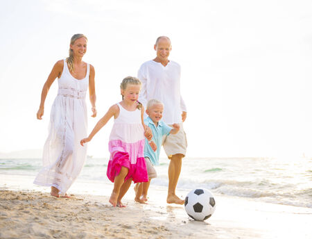 Family playing on the beach  photo