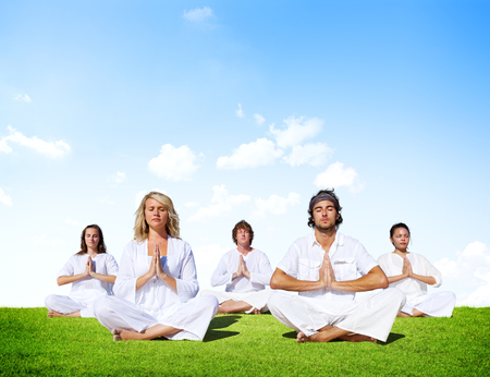 Multiethnic Group of People Meditating Outdoors photo