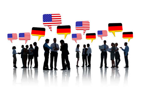 Group Of American And German Business People Talking To Each Other In A White Background photo