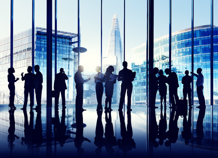 working office: Silhouettes Of Multi-Ethnic Group Of Business People Working Together Indoors