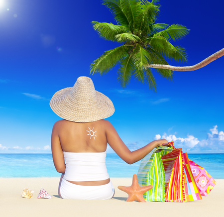 holiday spending: Woman on Holiday by the Beach with Shopping Bags