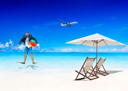 away from it all: Businessman by the Beach Getting Away From it All