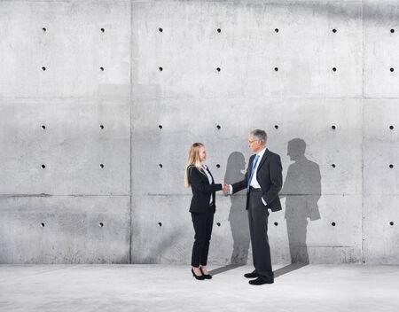 industrial: Business Handshake on an Industrial Building
