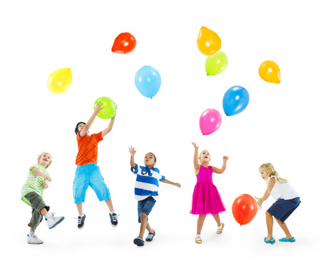 arms raised: Happy Multi-Ethnic Children Playing Balloons Together