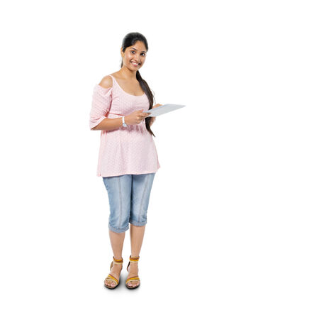 Cheerful Casual Woman Holding Digital Tablet photo
