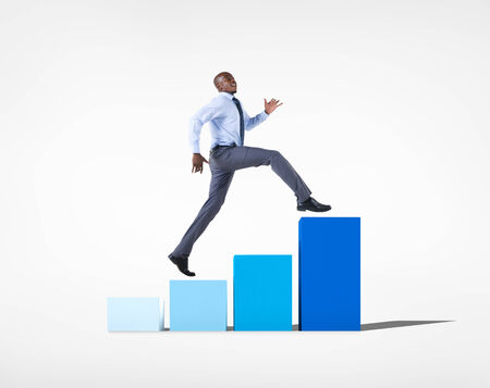 Businessman jumping on a developing graph  photo
