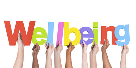 the wellbeing: Diverse Hands Holding The Word Wellbeing
