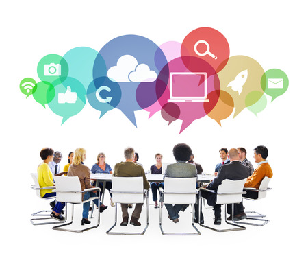 Multiethnic People in a Meeting with Social Media Symbols photo