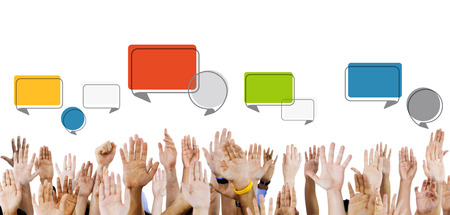 Multiethnic Hands Raised with Speech Bubbles photo