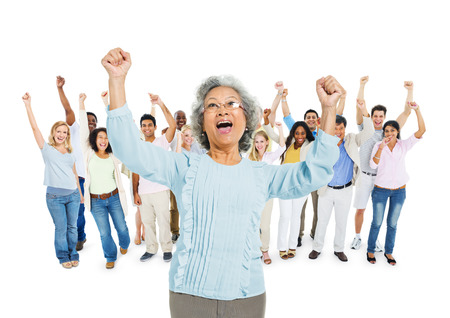 celebrating: Group of Diverse Multi Ethnic People Celebrating together with their Arms Raised