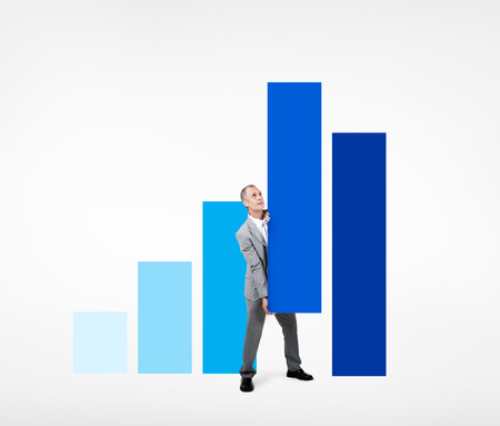 Business Man Holding a Bar Graph to Improve photo