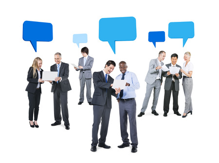 Group of Business People Discussing about Different Ideas with Speech Bubbles Above Them photo