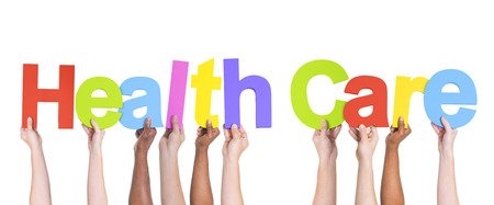 Group of Multiethnic Hands holding Health Care photo