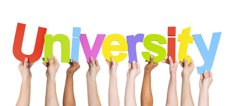Diverse Hands Holding The Word University Imagens