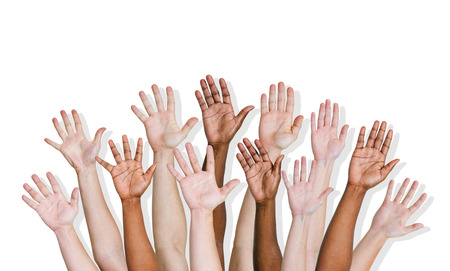 Group of human arms raised  photo