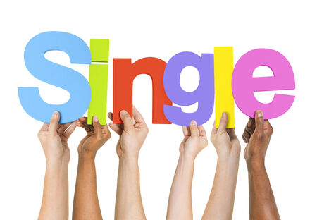 unmarried: Diverse Hands Holding the Word Single Stock Photo