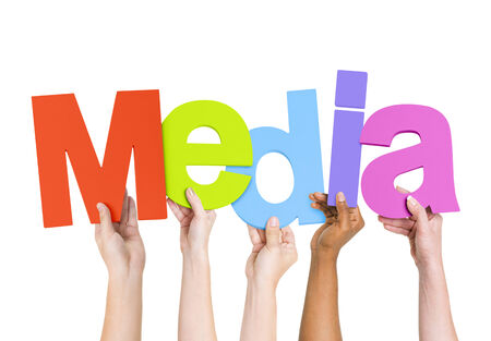 Multi Ethnic People Holding The Word Media Reklamní fotografie