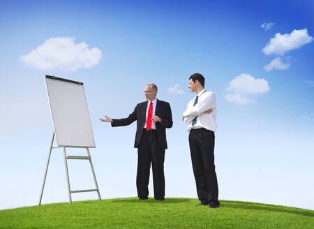 Business Man Pointing Empty Whiteboard Outdoors photo