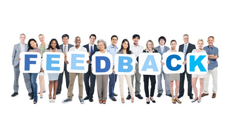 Group Of Happy Multi-Ethnic Business People Holding The Word Feedback  photo