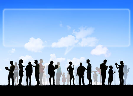 Group Of Multi-Ethnic People Social Networking Outdoors And Empty Billboard Speech Bubble Above photo