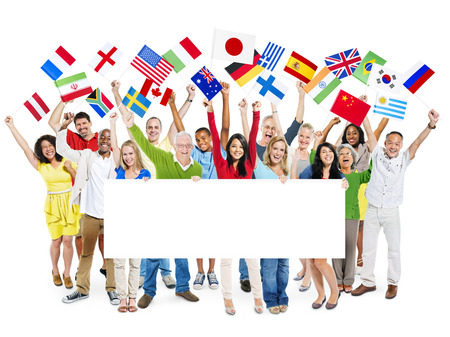 international people: Large group of diverse cheerful multi-ethnic casual people celebrating while holding flags and a white placard  Stock Photo