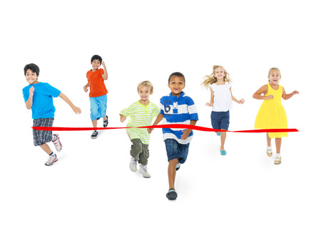multi ethnic children: Studio Shot of Children Running Toward the Finish Line