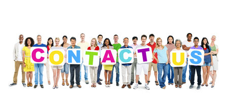 contact: Multi-ethnic group of people holding cardboards forming contact us  Stock Photo