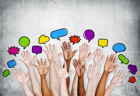 Multiethnic People Arms Raised with Speech Bubbles photo