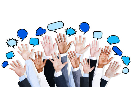 Multi Ethnic Business People Arm Raised with Speech Bubble photo