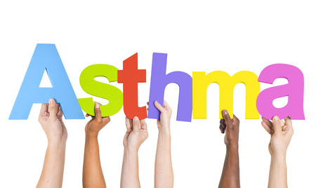 inhaler: Diverse Hands Holding The Word Asthma Stock Photo