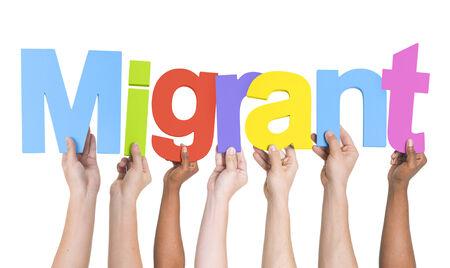 migrant: Multiethnic Arms Raised Holding Text Migrant