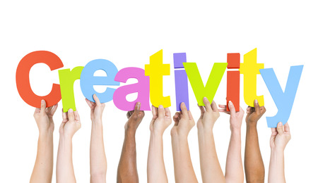 Multi-Ethnic Hands Holding Colorful Letters To Form Creativity Stock Photo