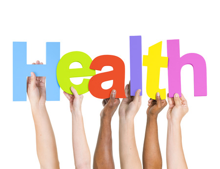 Multi-Ethnic Hands Holding Colorful Letters To Form Health Stock Photo