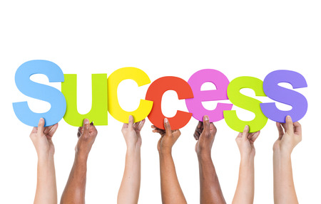 great job: Multi-Ethnic Group Of People Holding The Word Success Stock Photo