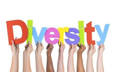 言葉の多様性を保持している多様な手 写真素材
