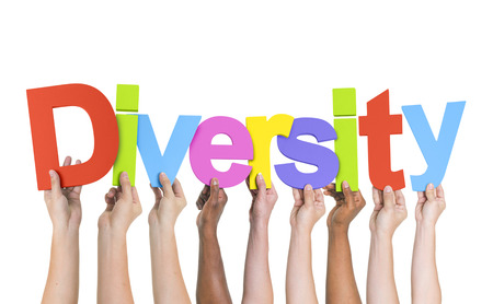 Diverse Hands Holding The Word Diversity photo