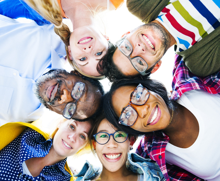 head to  head: Group of Multi Ethnic Casual People with their Heads Together Showing Friendship