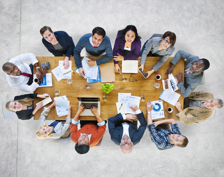 Multi-Ethnic Group of People in a Meeting Looking Up photo