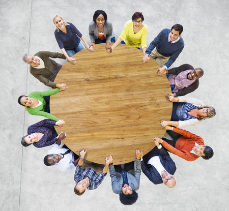 Multiethnic People Forming a Circle Holding Hands photo