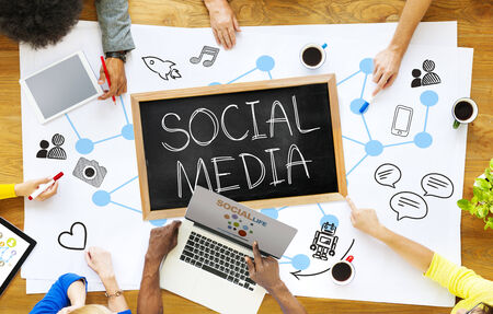 social life: Group of Multiethnic People Discussing Social Media Stock Photo