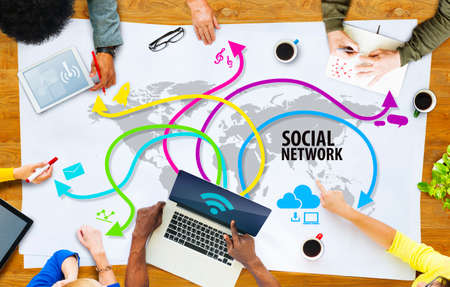 Group of Multiethnic People Discussing Social Network