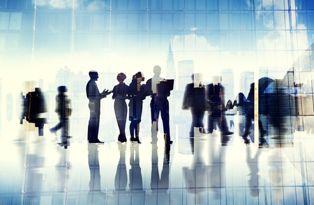 BUSY OFFICE: Silhouettes of Business People Inside the Office Stock Photo