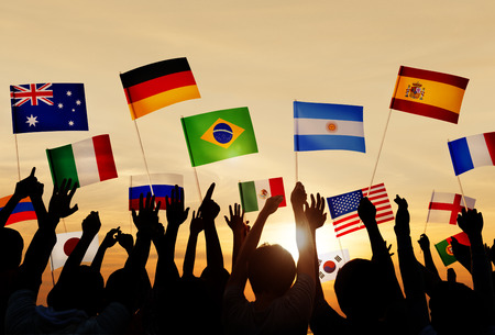 Silhouettes of People Holding Flags From Various Countries photo