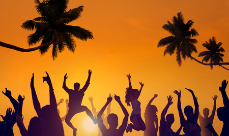 Silhouettes of Young People Partying on a Beach photo